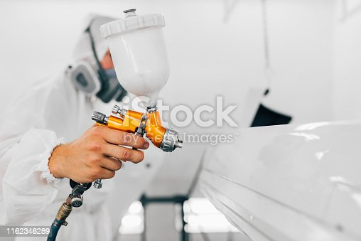 istock Close-up image of professional car painting, focus on the foreground. 1162346289