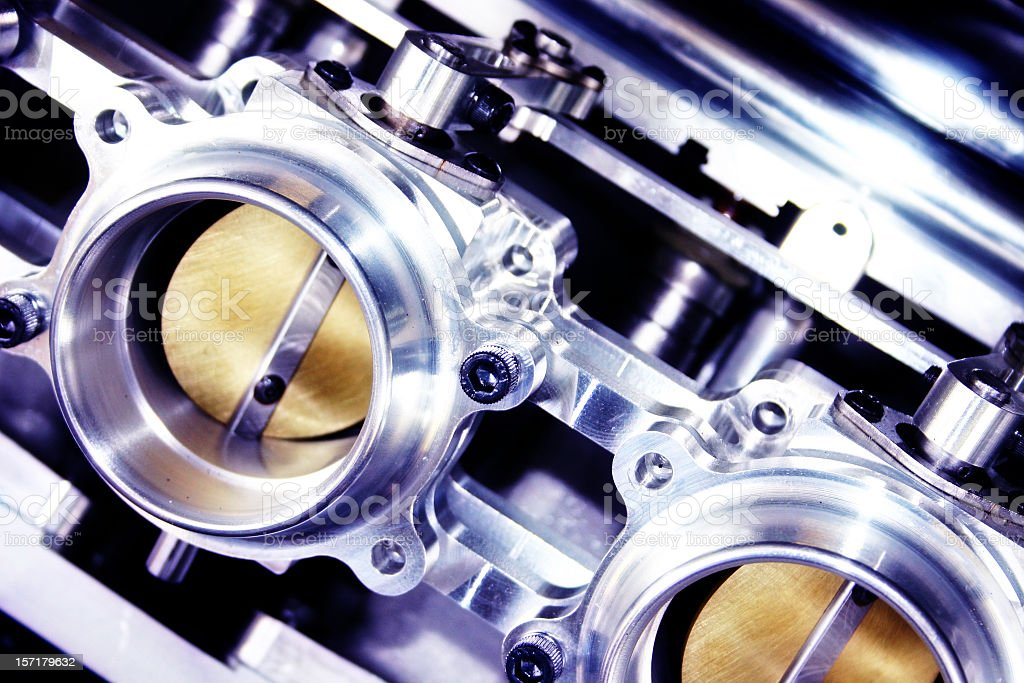Close-up image of shiny metal parts inside an engine royalty-free stock photo