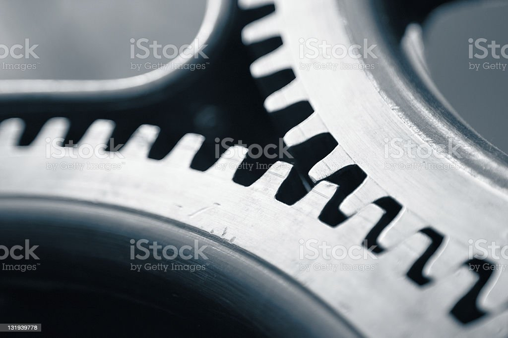 Close-up image of silver colored cog wheel stock photo