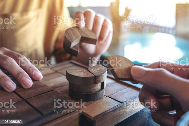 Closeup image of two people playing and building round wooden puzzle picture id1064989082?b=1&k=6&m=1064989082&s=612x612&h=hnypfxt9dzghezimz44ecq2gd r8eilchieccac4l1w=