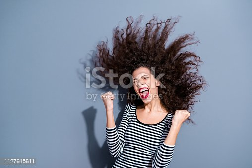 Closeup image portrait of pretty attractive nice good glad overjoyed funny funky person lady raising hands fists up open mouth isolated grey background