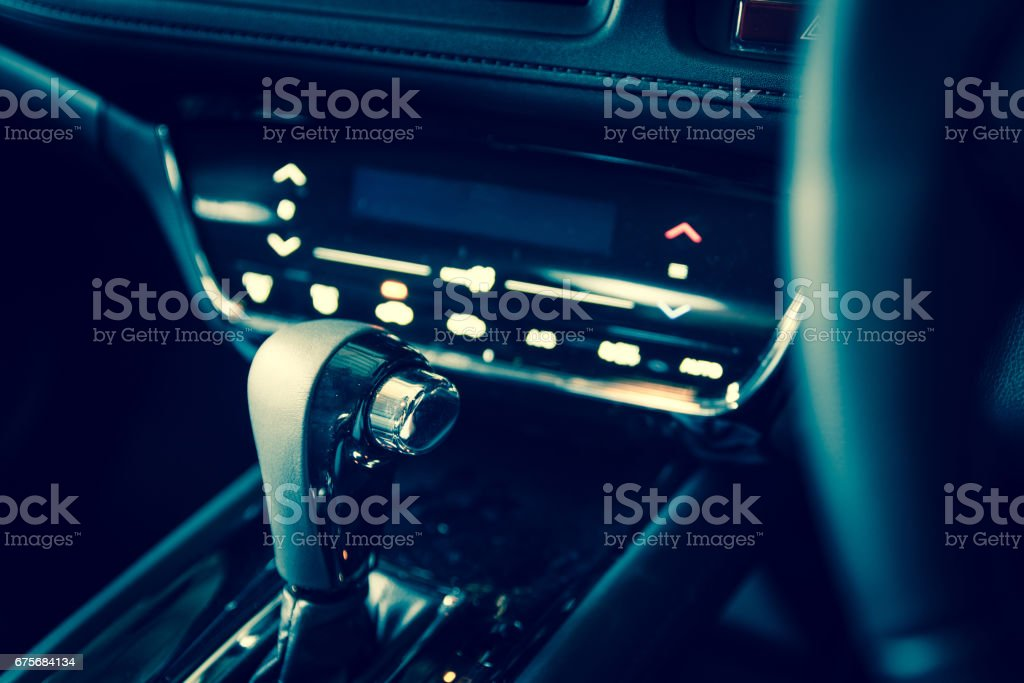 Closeup interior modern car console with full windscreen show space of front seat and passenger cabin , gear box , steering wheel and whole of dashboard function. royalty-free stock photo