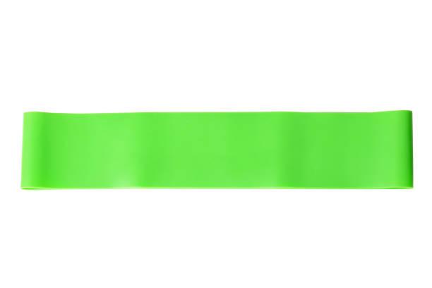 close-up isoliert grünen sport armband für stretching - armband i gummi stock-fotos und bilder