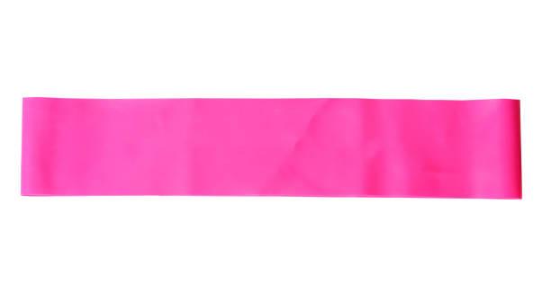 close-up isoliert rosa sport armband für das dehnen - armband i gummi stock-fotos und bilder