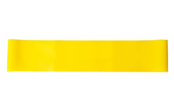 close-up isoliert gelb sport armband für stretching - armband i gummi stock-fotos und bilder