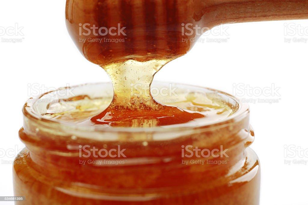 Close-up jar of honey on white background stock photo