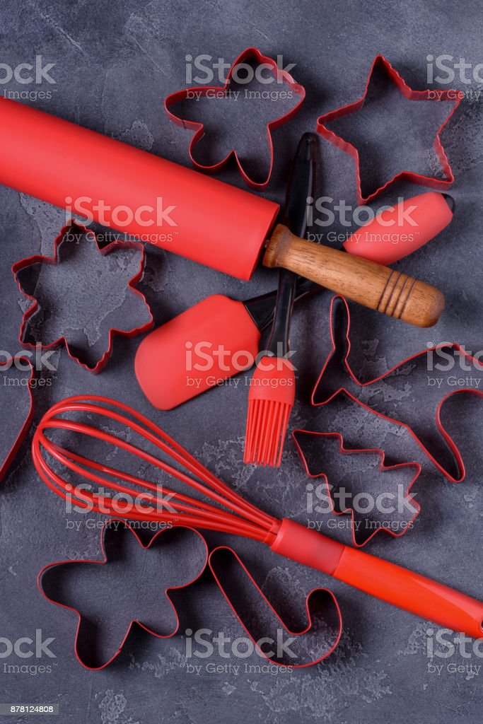 Closeup kitchen utensils and cookies cutters stock photo