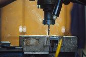 Vertical metal milling machine. Close-up lathe machine. Steel drill machine.