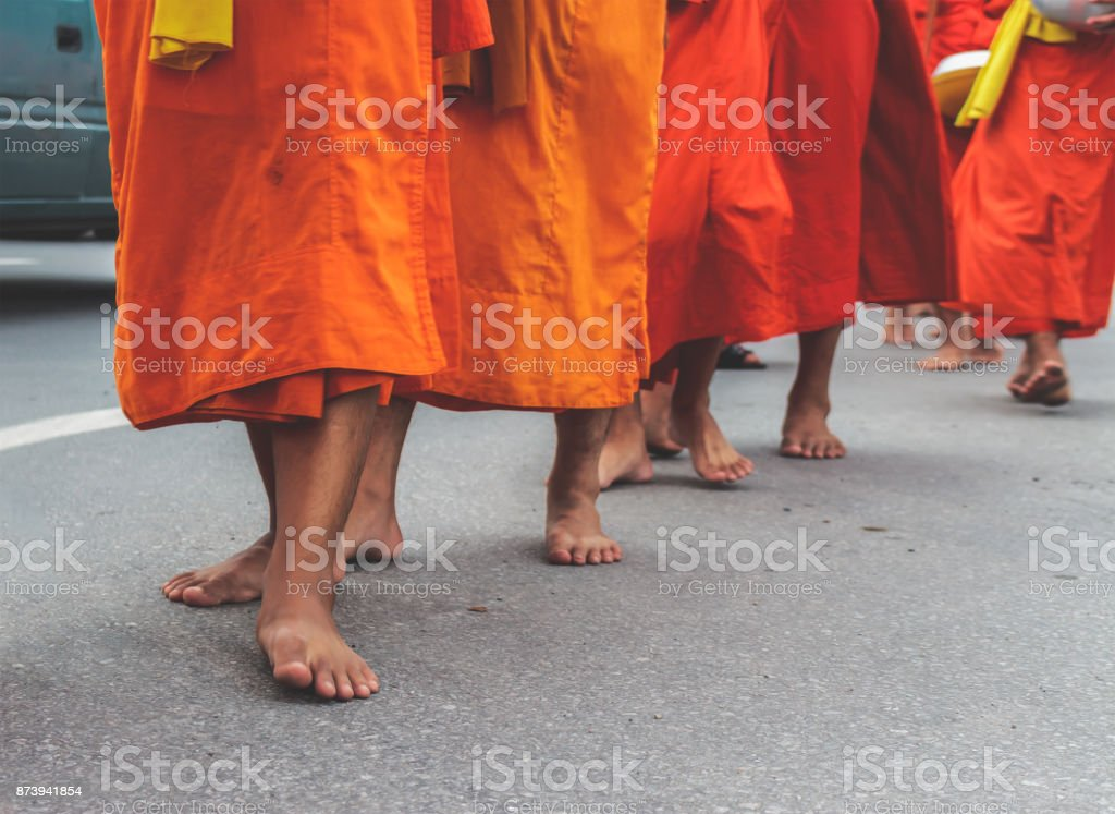 closeup legs of monk with soft-focus in the background. over light stock photo