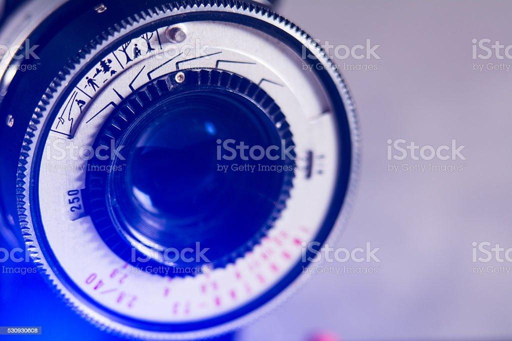 Close-up lens Photo Film camera with a purple light stock photo