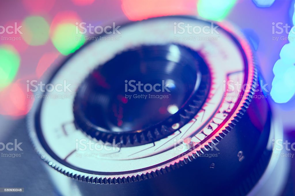 Close-up lens Photo Film camera with multicolored lights in stock photo