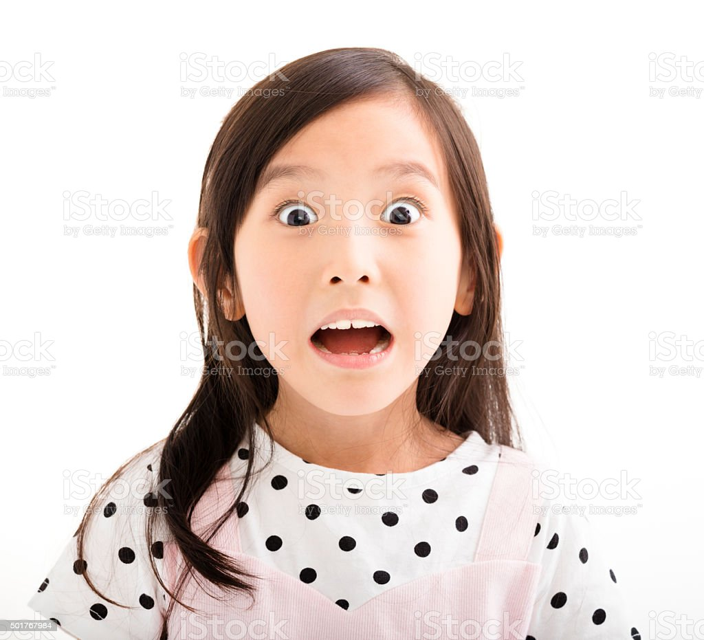 closeup little girl with surprised face stock photo