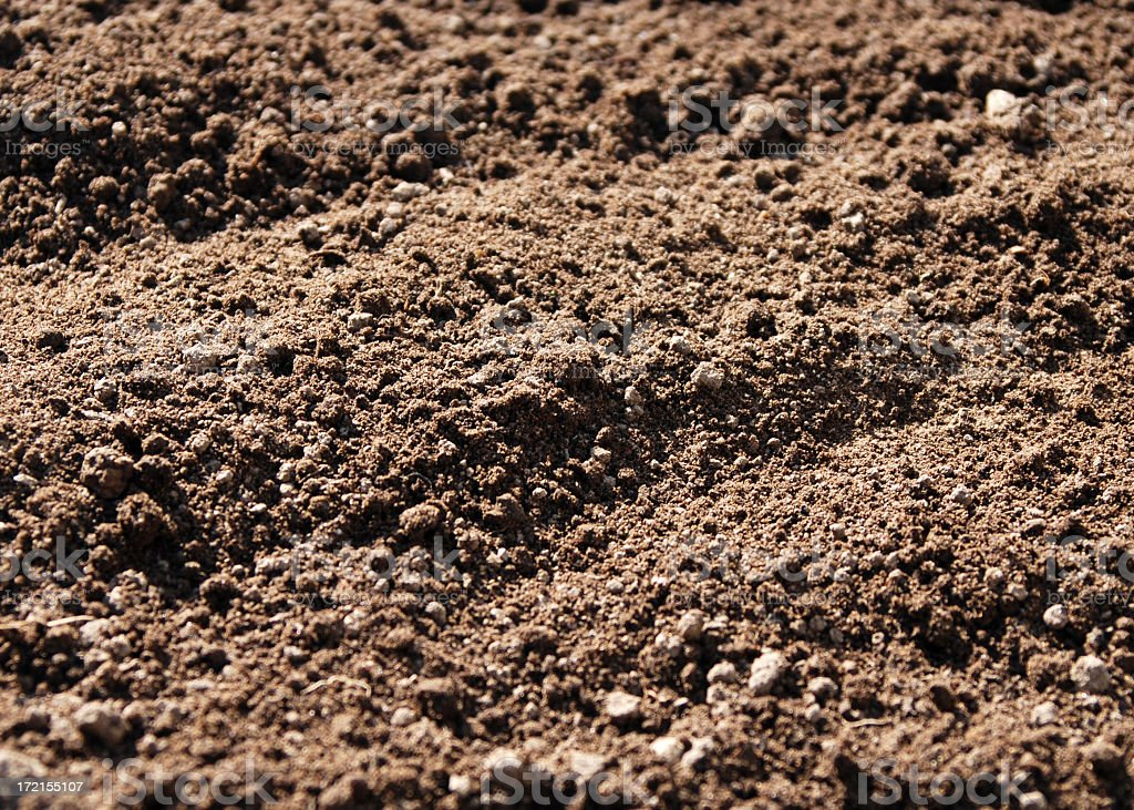 Close-up look at brown soil and dirt stock photo