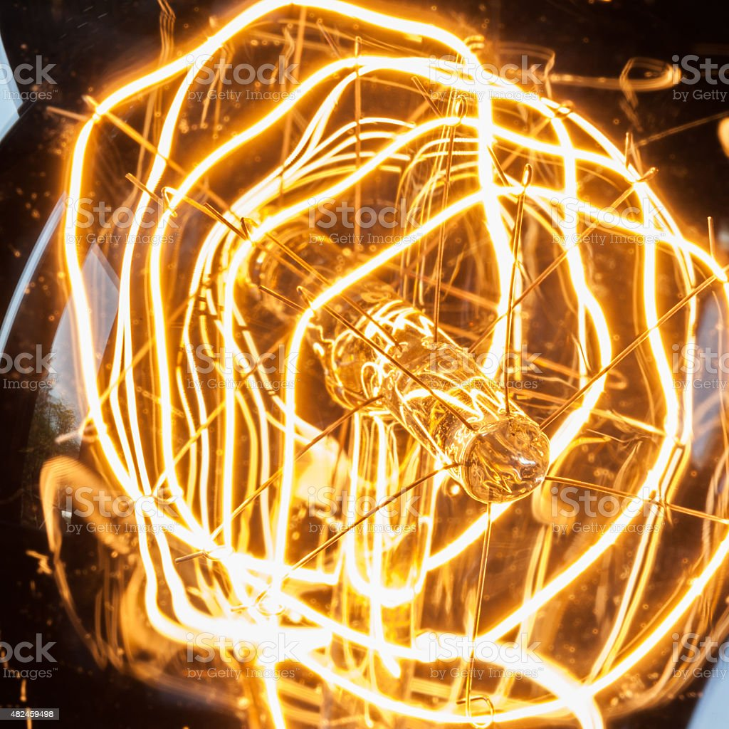 Closeup looping carbon filament of vintage edison light bulb. stock photo