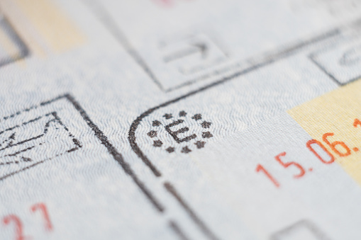 istock Close-up macro detail of Spanish European Union admission stamp 1199179680