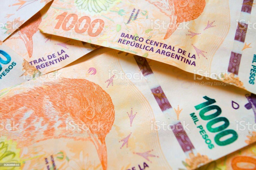 Close-up macro of bills of 1000 Argentine pesos disordered stock photo