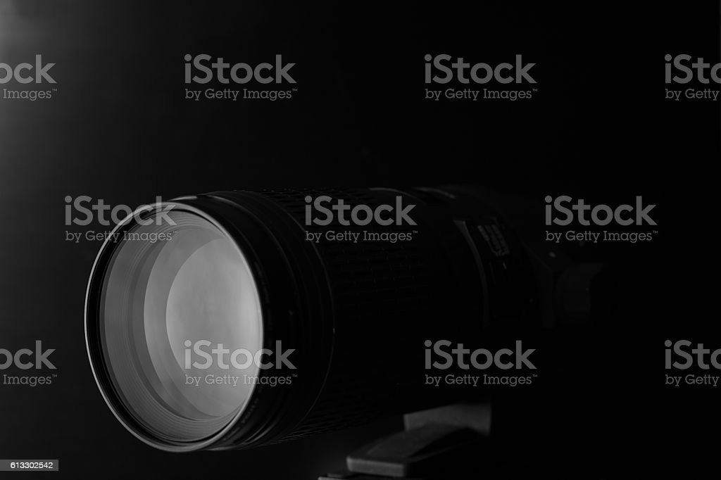 closeup macro of camera lens with reflections low key image stock photo