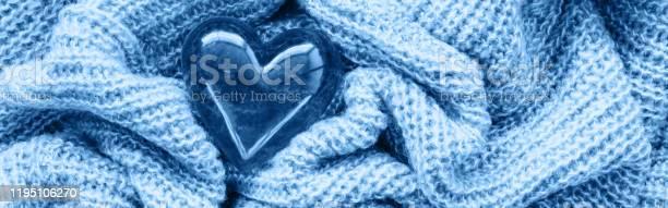 Closeup macro of classic blue knitted wool fabric with glass heart picture id1195106270?b=1&k=6&m=1195106270&s=612x612&h=nzd 9hew8sszfndifsi2rh66chzaqaq0qg30mftfwwk=
