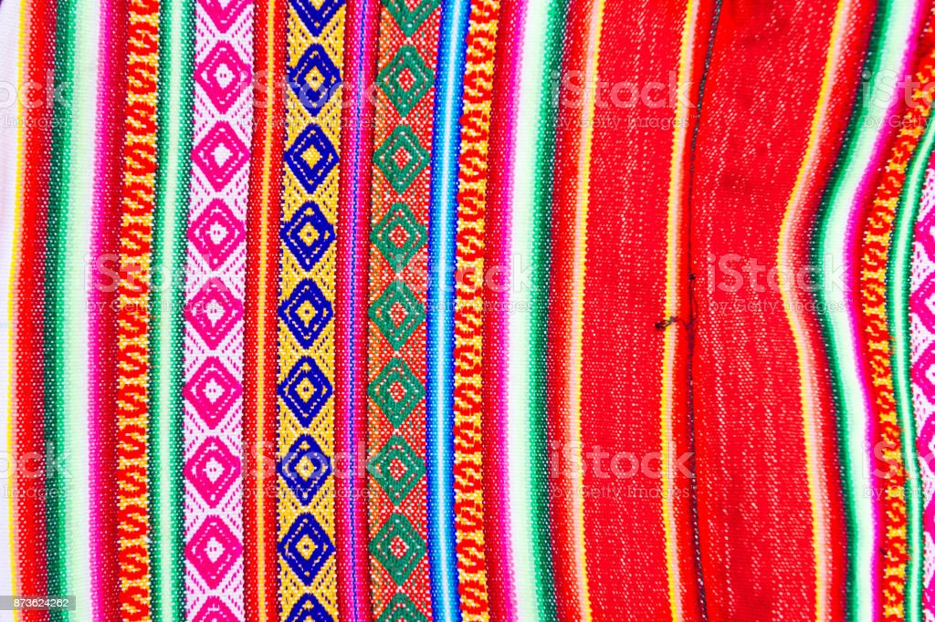 Close-up macro of colorful handmade fabric with Peruvian motifs stock photo