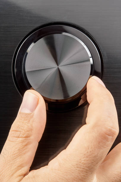 Closeup male hand turning blank knob stock photo