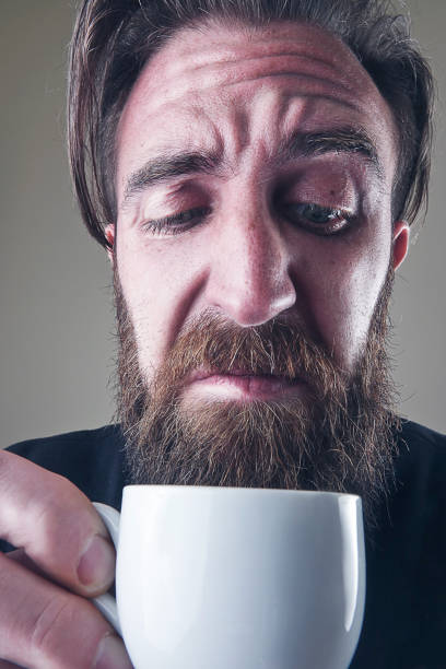 Close-up man with ugly coffee cup - foto stock