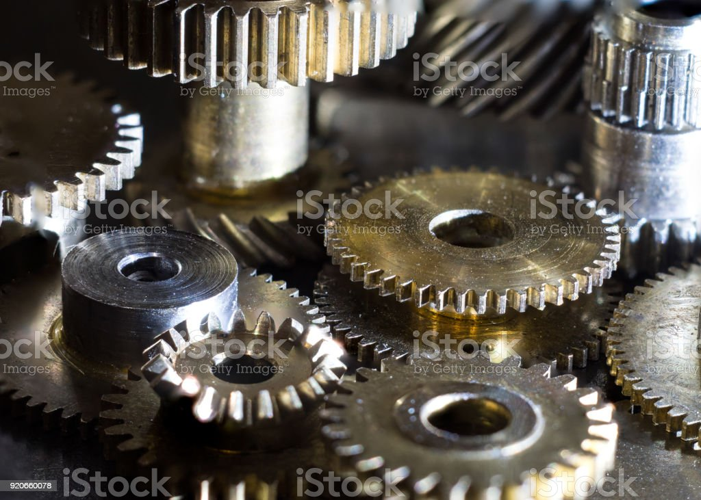 close-up mechanical metal wheels in various sizes close-up mechanical metal wheels in various sizes Accuracy Stock Photo