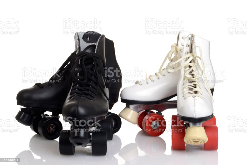 closeup men's and women quad roller skates stock photo