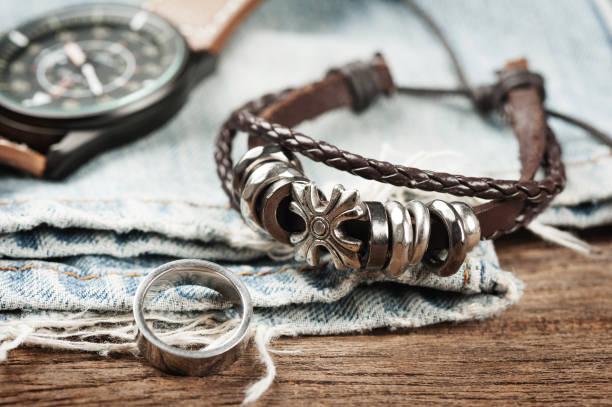 closeup men's bracelet - браслет стоковые фото и изображения