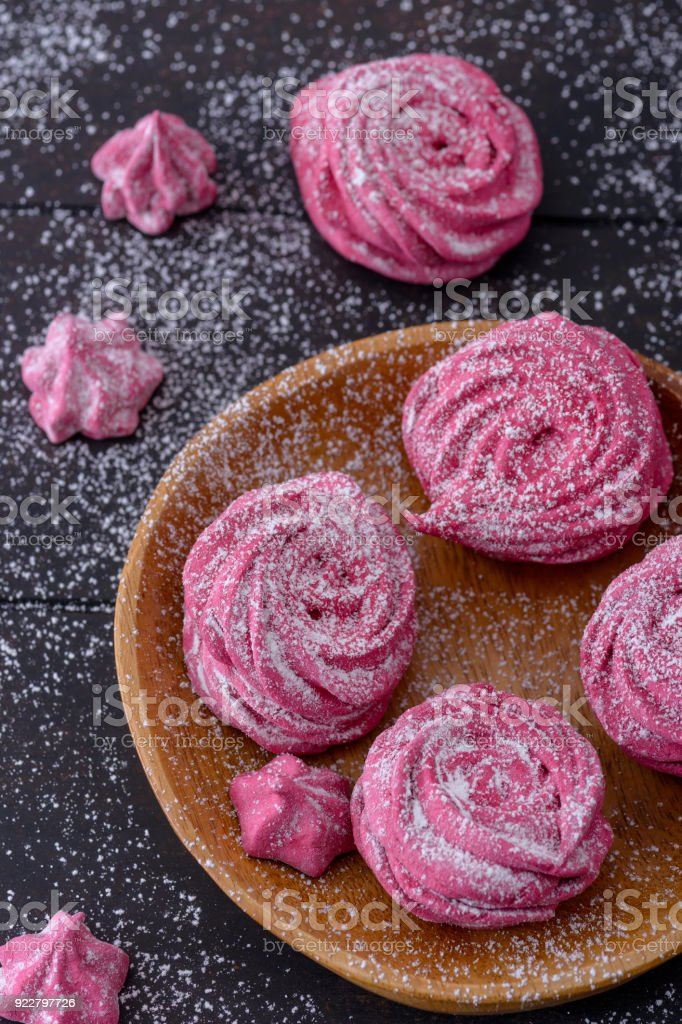 Close-up meringues cookies on wooden plate stock photo