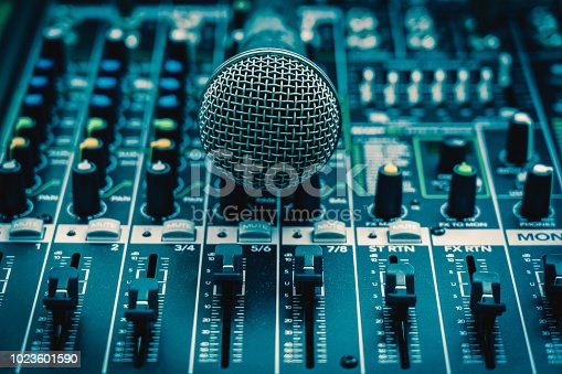 istock Closeup microphone over the audio mixer, vintage film style, music equipment concept 1023601590