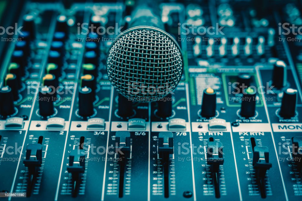 Closeup microphone over the audio mixer, vintage film style, music equipment concept stock photo