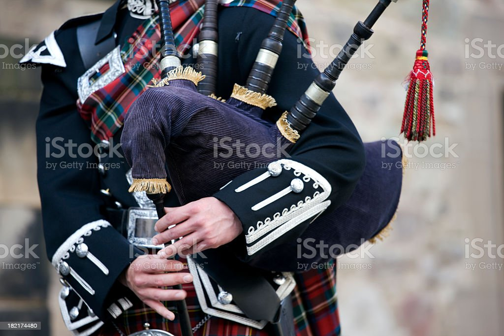 Close-up mid section of a man playing the Scottish bagpipes stock photo