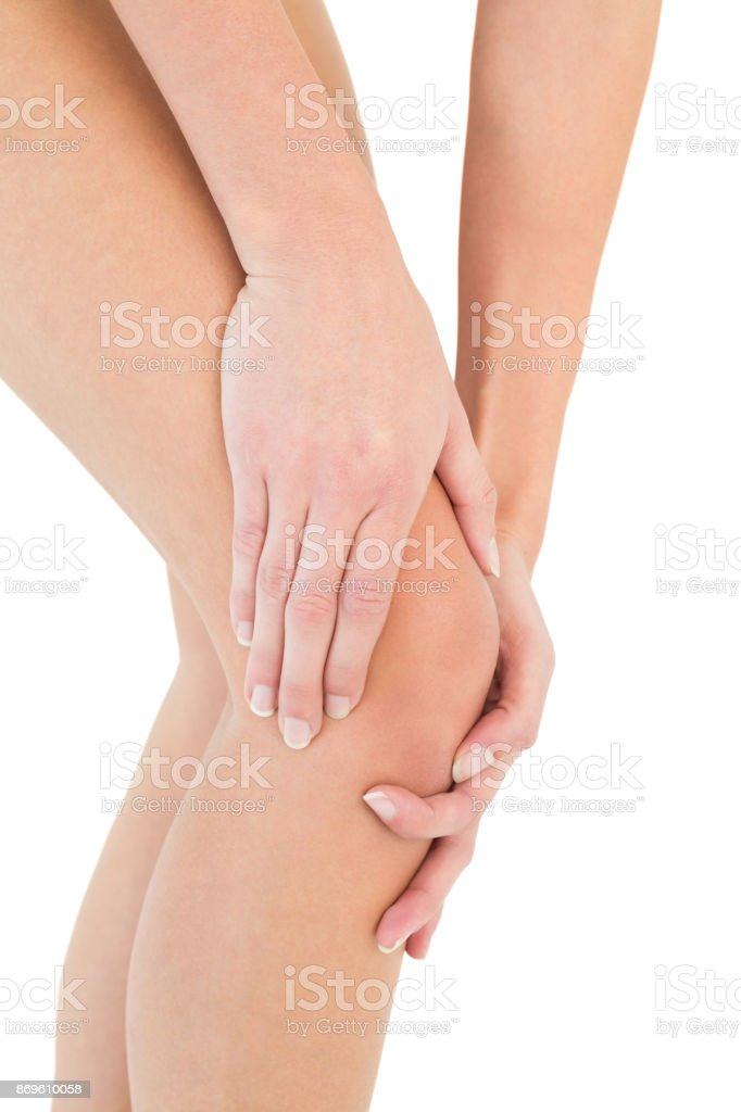 Closeup mid section of a woman with knee pain stock photo