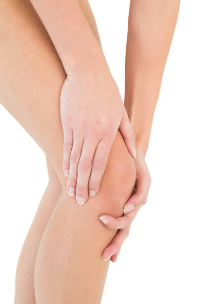 closeup mid section of a woman with knee pain - human knee stock photos and pictures