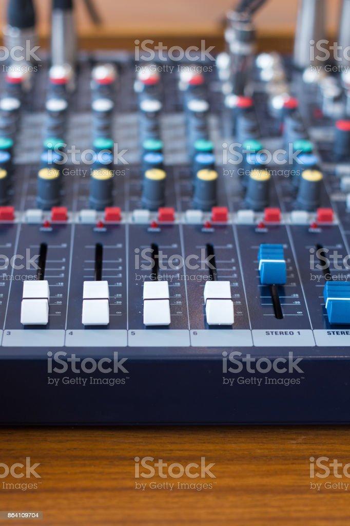 Closeup mixer in recording room. Closeup button to increase or decrease sound royalty-free stock photo