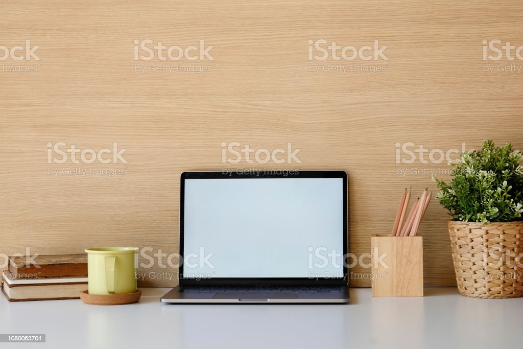 Closeup Mockup Laptop On White Table Books Coffee Pencil In The