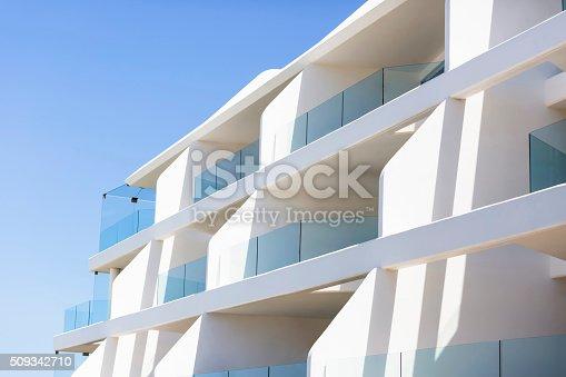 istock Closeup modern apartment building against blue sky, copy space 509342710