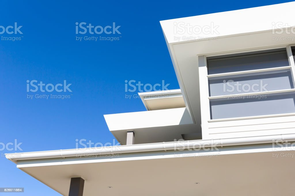 Closeup modern house against blue sky background with copy space stock photo