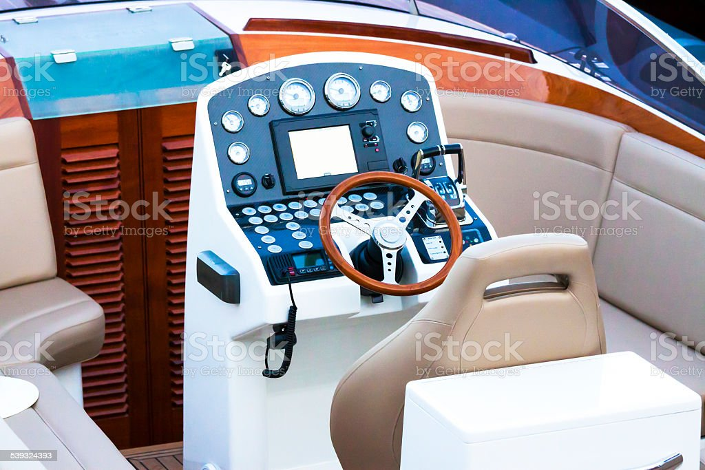 Closeup modern speed boat cockit control panel with leather seats stock photo