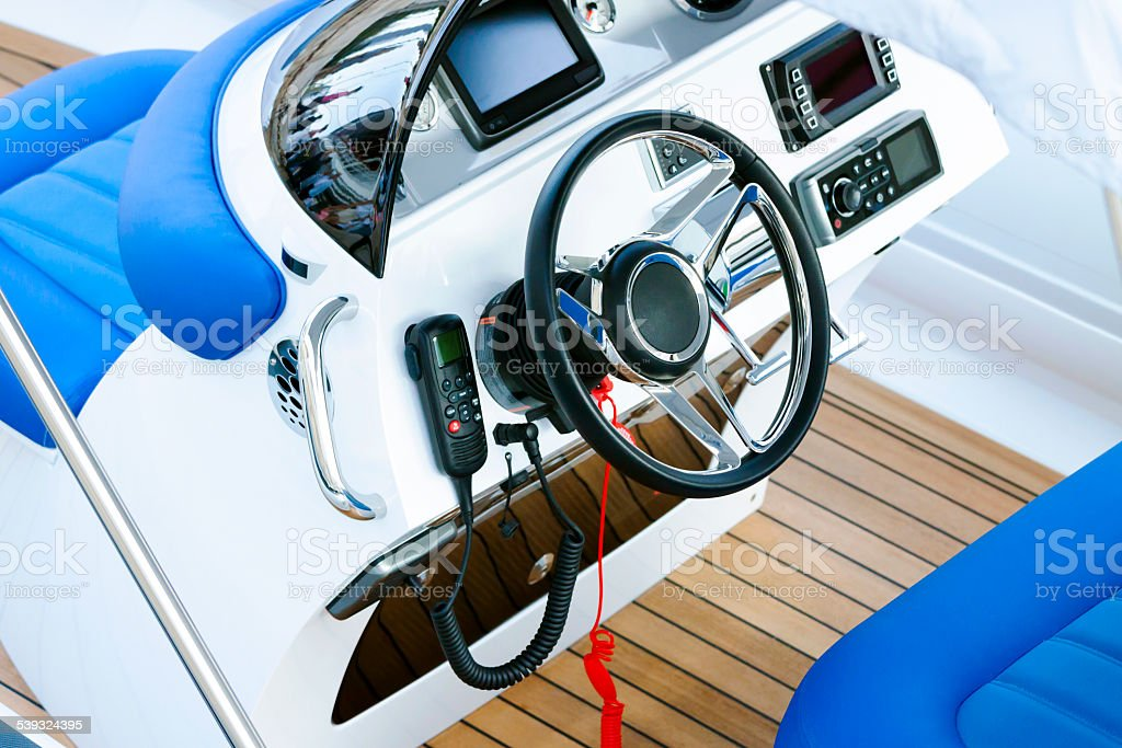 Closeup modern speed boat cockpit control panel with CB radio stock photo