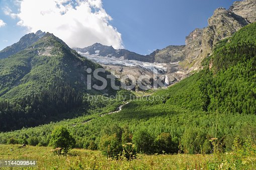 Closeup mountains scenes in national park Dombay, Caucasus, Russia, Europe. Sunshine weather and blue sky, summer day