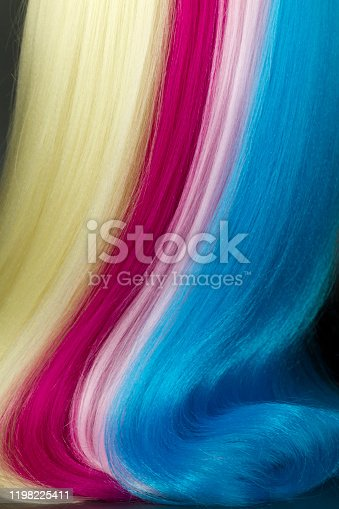 Close-up multi colored hair texture on black background,  studio shot