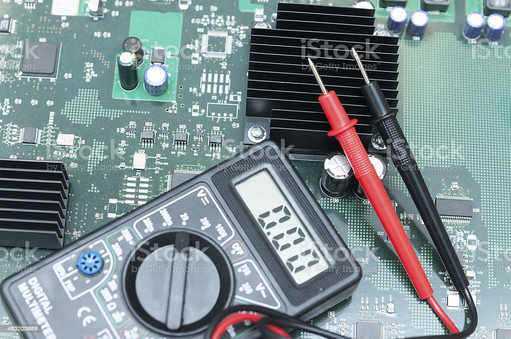 Close-up multimeter on PCB plate. stock photo