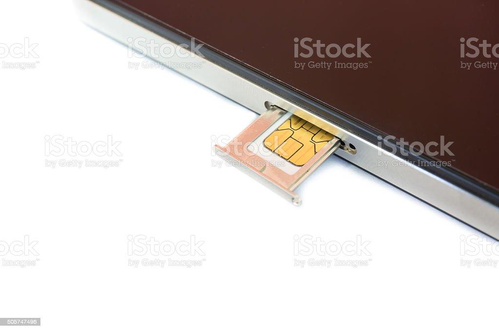 Closeup Nano SIM card ready to insert to smartphone stock photo