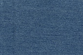 Closeup navy blue,jean color fabric texture. Strip line dark blue,jean,indigo blue fabric pattern design or upholstery abstract background.