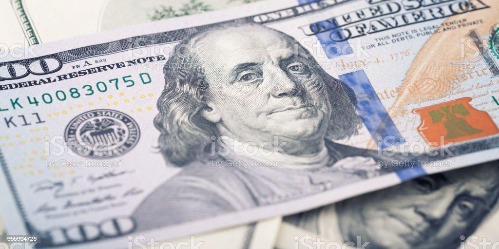 Closeup new American money hundred dollar bill. Benjamin Franklin portrait, us 100 dollar banknote fragment macro stock photo