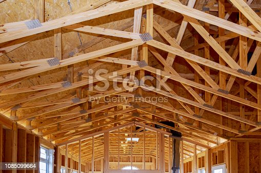 Framing structure wood frame of wooden houses home. Closeup new stick built home under construction under blue sky. real estate concept background.