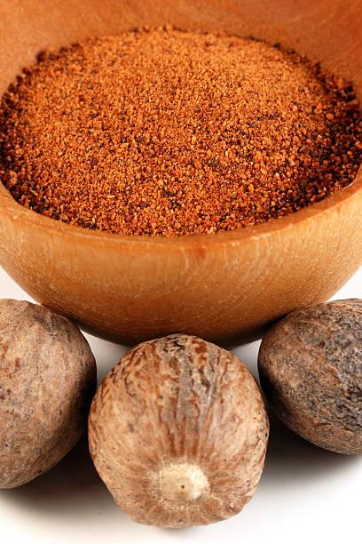 Close-up Nutmeg nuts and powder stock photo