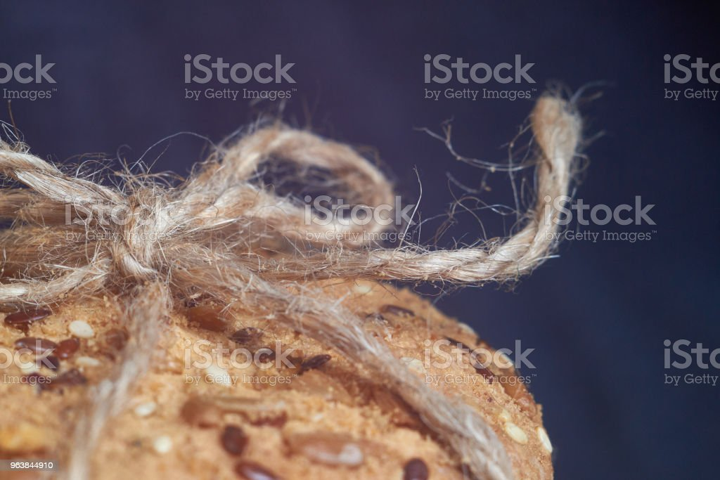 closeup oat large biscuits with sesame, flax and sunflower seeds. Macro - Royalty-free Bakery Stock Photo