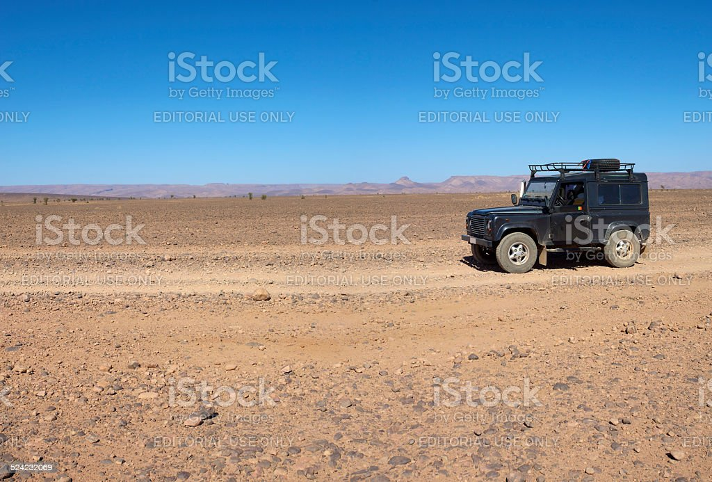 Close-up of 4X4 car with desert background stock photo